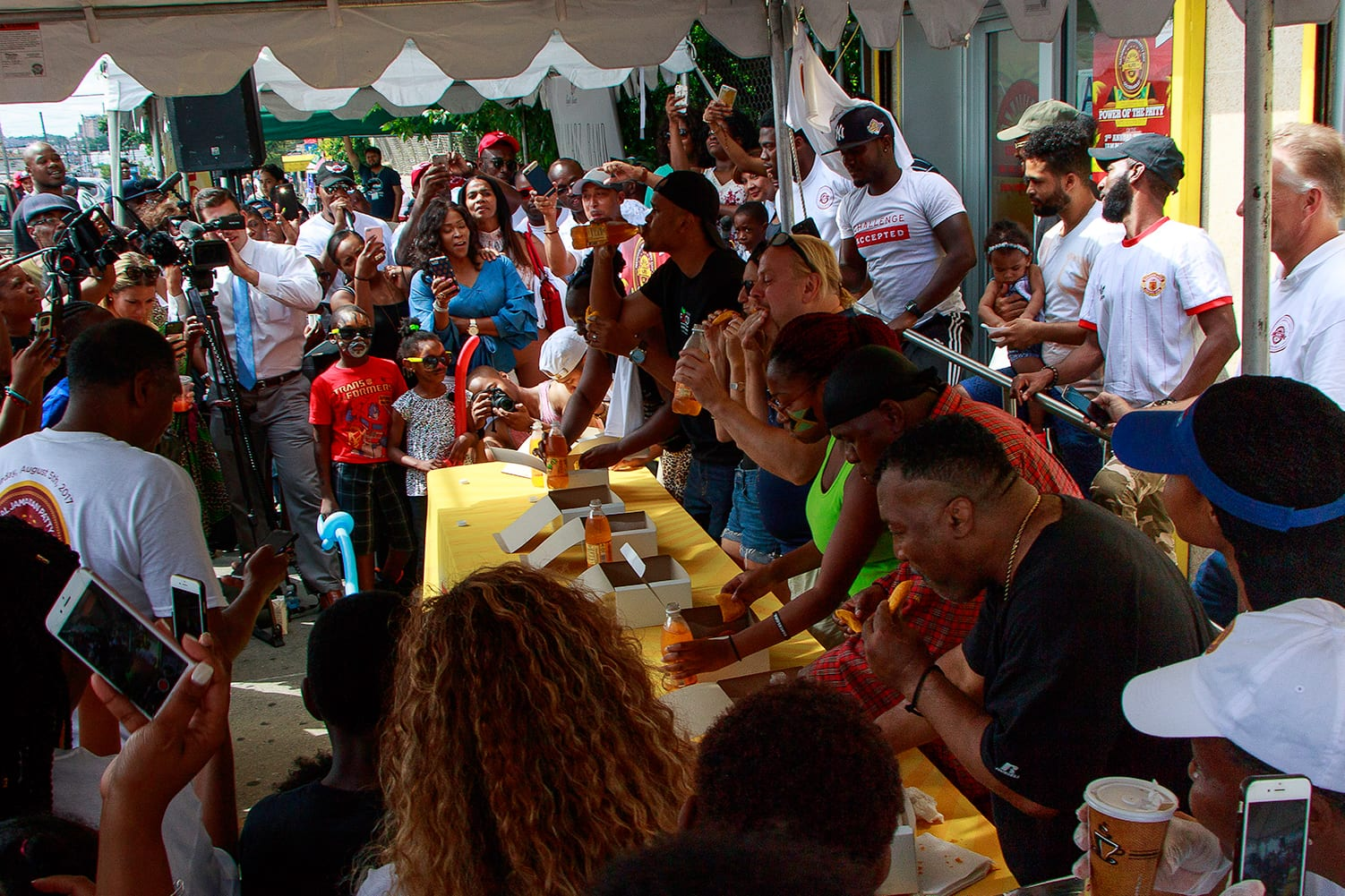 Patty eating contest during the national jamaican patty day celebration